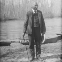 Man near Row Boats in River 1900.jpg