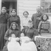 Group of Nine Near Wood Frame Building 1899.jpg